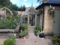 This bespoke Alitex greenhouse is small but perfectly formed. https://alitex.co.uk/bespoke-greenhouses