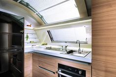 New Smart kitchen with gas burners, sink, worktop, oven and large fridge. Airstream Camping, Glamping, Trailers, Camper Van Kitchen, Large Fridge, Gmc Motorhome, Smart Kitchen, Rv Life, Mobile Home