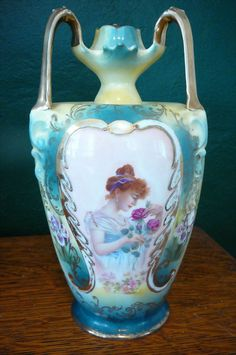 Large R.S. Prussia Portrait Vase Lady with Roses. The vase has an unusual mold with three handles