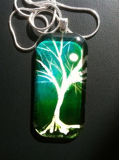 Glowing Green Moonlit Tree In Winter Art by DomeLifeStudios, $18.00