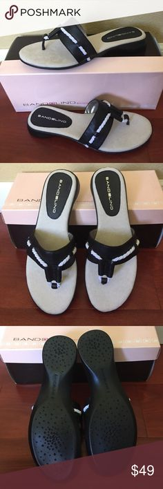 Bandolino Black & White Thong Slipper Sandal Shoes New unworn in box Bandolino Jacquline black thong sandals. Size: 6 . Fashionable thong sandal with rope detail. Black Leather upper With white rope detail.  Padded pillow top footbed. Flexible man-made sole. 1 1/4 inch heel.  These are so comfortable. Like walking on a pillow  Bandolino Shoes Flats & Loafers