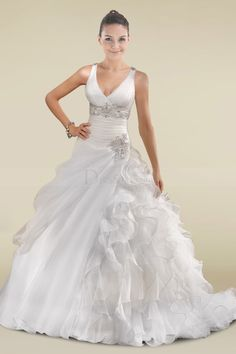 wedding dress! http://www.dressale.com/sophisticated-aline-wedding-dress-with-beaded-applique-and-intricate-ruffles-p-28204.html