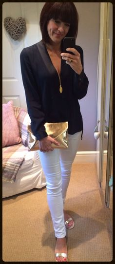 Navy satin edged blouse with white skinny jeans & metallic accessories. Full details including shop my style at www.mymidlifefashion.com