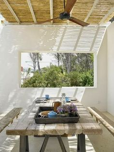 Bathed by the Mediterranean light...the 'paranga' is a bamboo or reed shade used for outdoor areas in Greece etc.