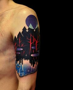 What a gorgeous, bold, graphic tattoo. A truly unique design for a half sleeve. Couldn't you get lost in that forest?