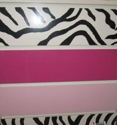 When decorating, don't forget to paint furniture to match a themed room. Love this zebra dresser. This was a plain IKEA dresser, but now it ties the room together.