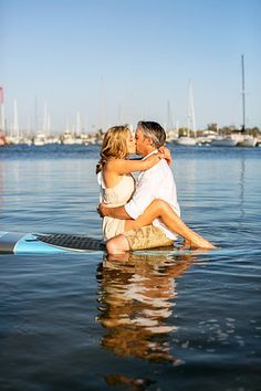 Stand up Paddle Board Engagement Session   Photos by: CHARD Photography | www.chardphoto.com     styled by Events by Cassie | www.eventsbycassie.com