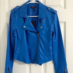 Blue Vegan Leather Moto Jacket Brand new and unworn. It's from the Nasty Gal site. It's Cobalt blue, the color is better in person. It's extremely soft vegan leather. I'm open to reasonable offers but NO TRADES. Don't ask for my lowest, use the offer button. Nasty Gal Jackets & Coats