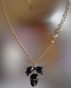 Tarina Tarantino Black Skull Crystal With Bow Necklace New - http://elegant.designerjewelrygalleria.com/tarina-tarantino/tarina-tarantino-black-skull-crystal-with-bow-necklace-new/