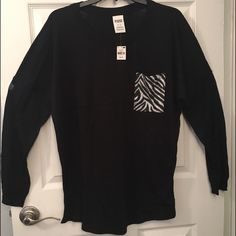 """VS PINK Long Sleeve Tee With Zebra Stripe Pocket VS PINK Black Long Sleeve Tee with Zebra Stripe Pocket on Front.  New With Tags.  Size Medium.  This is a lightweight and comfy tee.   See pictures.  No trades.  No holds.  All offers (lowest ?'s) via make """"offer"""" button only please (reasonable offers).  Thanks for looking and Happy Poshing! :) PINK Victoria's Secret Tops Tees - Long Sleeve"""