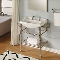 This attractive Metal Vanity from Empire is available in Satin Nickel finish. The 31 inch wide vanity has a two-leg design. It features towel bar options on both sides, left side, right side or no towel bar and a shelf for storage. The vanities come with a Biscuit Oxford ceramic top.