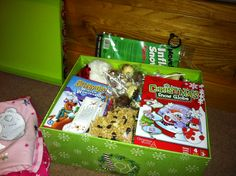 Christmas Eve Box - Include: New pajamas, a Christmas movie, popcorn, mugs, hot chocolate, marshmallows, and a Christmas book. This could definitely turn into a tradition.