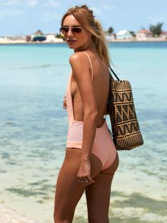 Eyes on Me One Piece | Super luxe seventies inspired one piece featuring a high neck and low open back. Mesh insert detailing.