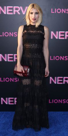Emma Roberts smoldered at the New York premiere of Nerve in a look that can be best described as goth-glam, which featured a stunning black lace tiered Elie Saab gown with a burgundy clutch and black sandals.