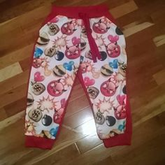 Emoji Printed Red Joggers Emoji on face and red on back. Two front pockets and draw string waist band. Unworn but without tag. 95% polyester 5% spandex Red Fox Pants Track Pants & Joggers