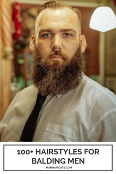 A geometrically trimmed long beard always pairs well with a taper haircut for balding men. Check out this list and find more ways to style your hair. #baldingmenhairstyles #taperhaircut #beardstyles #menhairstyles #manhaircuts