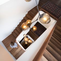 Harbour Front-Row Seat - Luigi Rosselli Architects/ Seven metre tall Lindsey Adelman chandelier dominates the stairwell. Staircase Handrail, Winding Staircase, Stair Treads, Staircases, Bubble Chandelier, Modern Chandelier, Architectural Features, Waterfront Homes, House And Home Magazine
