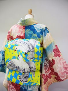 Kimono Nagoya. You have the soft watercolour like pattern and colours and organic shapes of the Kimono with the bold pop culture geometrics of the Obi. While the blue is echoed in both the Kimono and the Obi there's very little overlap in tone