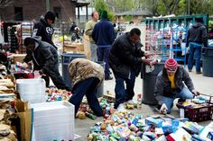 Grocery store is evicted, 300 people show up to pick through the food thrown out into the parking lot during the eviction, police run everyone off and guard the food as it is thrown into dumpsters