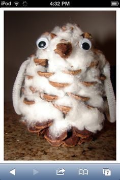 Owl made of a pinecone and cotton balls.