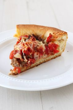Get that thick, slightly crisp, and buttery Chicago restaurant-style deep dish pizza at home with this recipe!