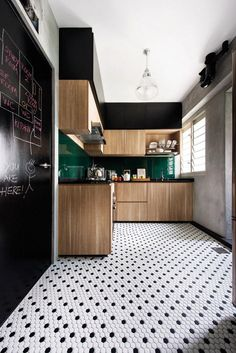 love the tiles, the emerald splashback, and the windows. The cabinet and chalkboard, not so much. Icky light. Don't like the black.