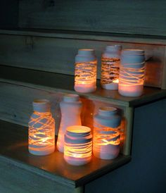 DIY Mason Jar lights - just wrap a yarn design around the jar before painting . so, once you add a candle or solar bulb, the light will shine through! Can also put stickers or rubber bands around the jar before painting to make designs! Pot Mason Diy, Diy Mason Jar Lights, Mason Jar Lighting, Mason Jar Crafts, Diy Jars, Diy Projects With Mason Jars, Reuse Jars, Crafts With Glass Jars, Solar Mason Jars