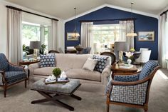 A dark denim-blue accent wall sets off the blue and white furnishings in this living room. The deep shade of blue also makes this spacious room look and feel cozier.    Suggested paint pick: Luxe Blue, Sherwin-Williams