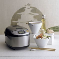 Developed in Japan by the makers of the original rice cooker, a microchip maintains perfect time and temperature to produce moist, fluffy rice time after time. Nonstick spherical bowl conducts heat evenly to prevent overcooking. Convenient carrying handle