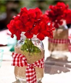 Decor idea: wrap mason jars with flowers in burlap and fabric tie.