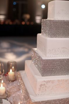 Get square cake stands, cover them with rhinestones and then put them between the cakes... genius!