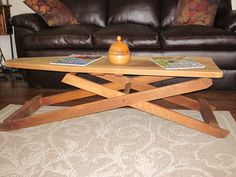 Antique ironing board used as coffee table.