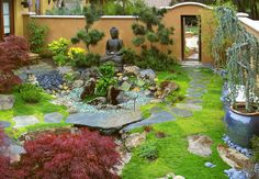Flagstone walk – flagstone bridge – Buddha – walled garden – stucco wall – entry gate