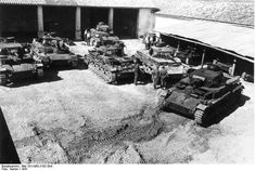 Group of Pz.Kpfw. III Ausf. D/E, under cover are three Pz.Kpfw. 38(t), France, 1941