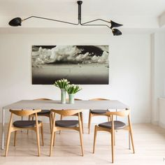 Great dining area the solid wood chairs gives a great contrast to the rest of the materials In this interior. #interior #furniture #decor #chair #lounge #dining #diningroom
