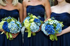 Bright blue bridesmaids bouquets add a pop of nautical color! {Piper Warlick Photography}