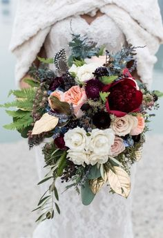 Winter bouquet, feathers, burgundy peony, white roses, fur shawl // Dawn E. Roscoe Photography