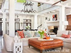 I love the neutral upholstery with colorful pillows and the leather ottoman to match! Breezy Lowcountry Home | Traditional Home