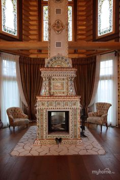 Just a wee bit over the top for a log cabin. Stove Fireplace, Wood Fireplace, Fireplace Surrounds, Fireplace Mantels, Fireplaces, Wood Stove Heater, Old Stove, Vintage Stoves, Cabins And Cottages