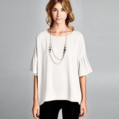"""Aclassic topwith a touch of modern. Effortless chic look withwide bell flutter half sleeves and hi-low hem gives you the perfect flare for the season. Goes nicely with jeans, leggings, shorts and even skirts.100% Polyester.Round neck.Wide bell flutter sleeves. Oversized.Made in USA.Wash in cold. Hang or line dry.Measurements:Small: Bust 46"""" / Length 28"""" / Arm circumference 14""""Medium: Bust 48"""" / Length 29"""" / Arm circumference 15""""Large: Bust 50"""" / Length 30"""" / Arm circu..."""