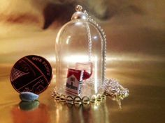 Cute bell jar necklace featuring a miniature pack by ModernChintz