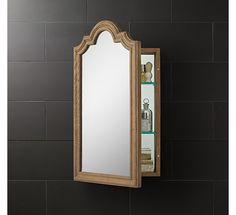 RH's Whitby Medicine Cabinet:Solid oak and the gracious curve of a Georgian arch create architecturally inspired bathroom storage.