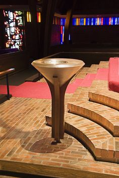 Baptismal font at Grace Lutheran Church, Corvallis, OR.  Note the Descending Dove sculpture/lamp suspended above.