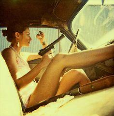 Smoking chick with handgun