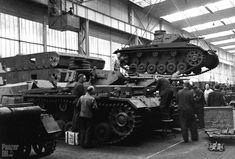 Panzerkampfwagen III (3,7 cm Kw.K. L/45) Ausf. F (Sd.Kfz. 141)  Assembly line of 4. Serie/Z.W. and 5. Serie/Z.W. circa 1938 or 1939. There's a Panzer I hull in the foreground.