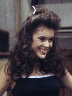 13 Hairstyles You Totally Wore in the '80s: Alyssa Milano's half-up, high, and mighty hair | allure.com