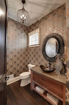 There's plenty to see in this powder room. The wallpaper was purchased through Hirshfields and is Seabrook; Panache Book; Pattern Number 62017.