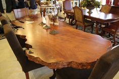 You can bring nature into your home with this large table and chair set! #shopGF | Houston TX | Gallery Furniture |