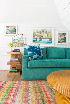 Hawaiian-theme paint-by-numbers and a waterfront scene detail the loft. These to… Hawaiian-theme paint-by-numbers and a waterfront scene detail the loft. Green Master Bedroom, Living Area, Living Room, Hawaiian Theme, Hawaiian Home Decor, Beverly Hills Hotel, Beach Bungalows, Duplex, Built In Desk