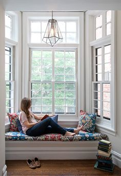 Window seat in bay window on second floor of a Federal row house in Brooklyn Heights renovated by CWB Architects.